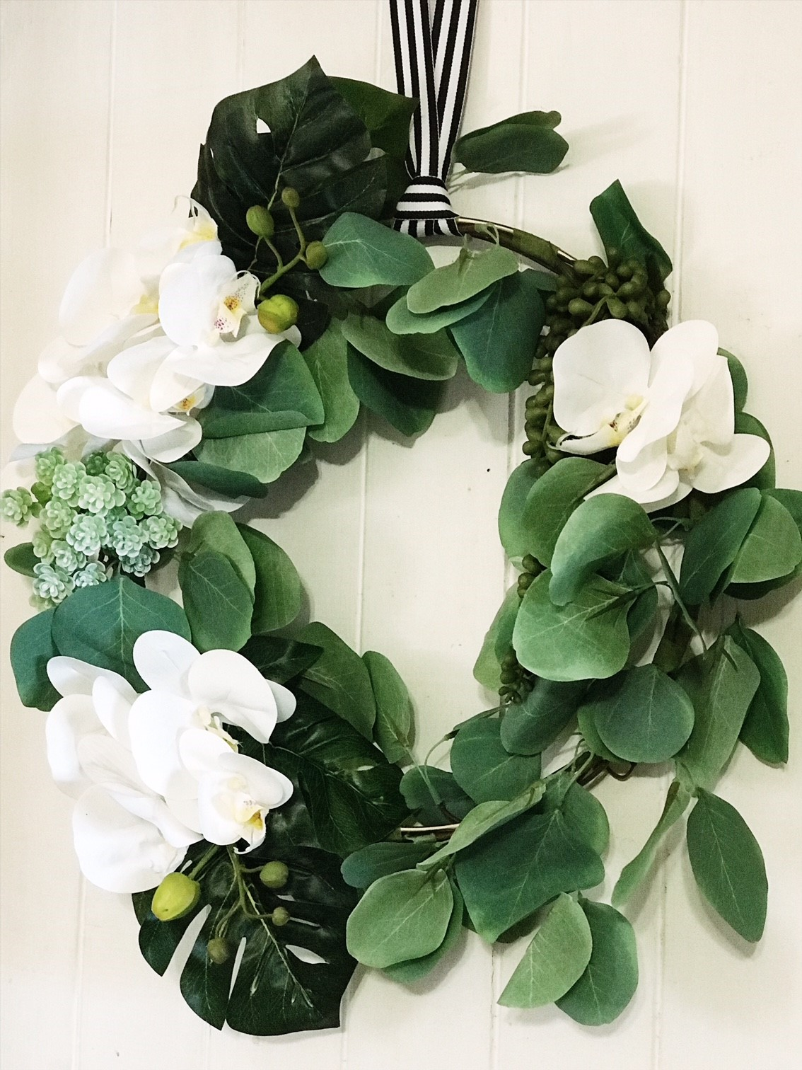 A DIY Tropical Wreath for Christmas - gorgeous faux leaves and succulents with orchids