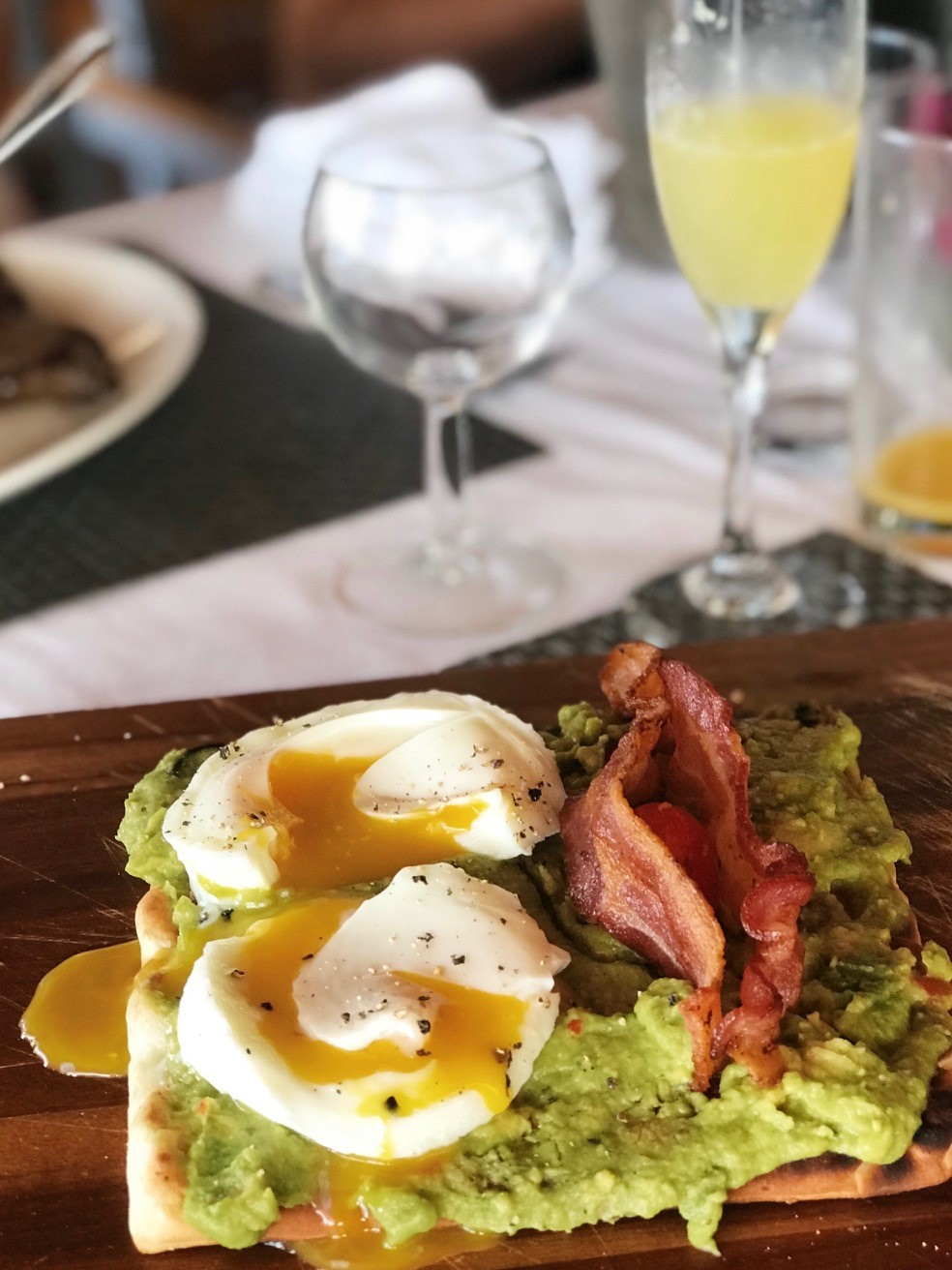 Sunday Brunch at Sugar Mill BVI - Avocado toast with poached eggs and bacon